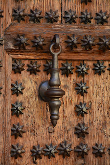 antique ornate door knocker and studs